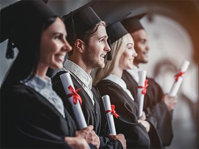 Students holding diplomas